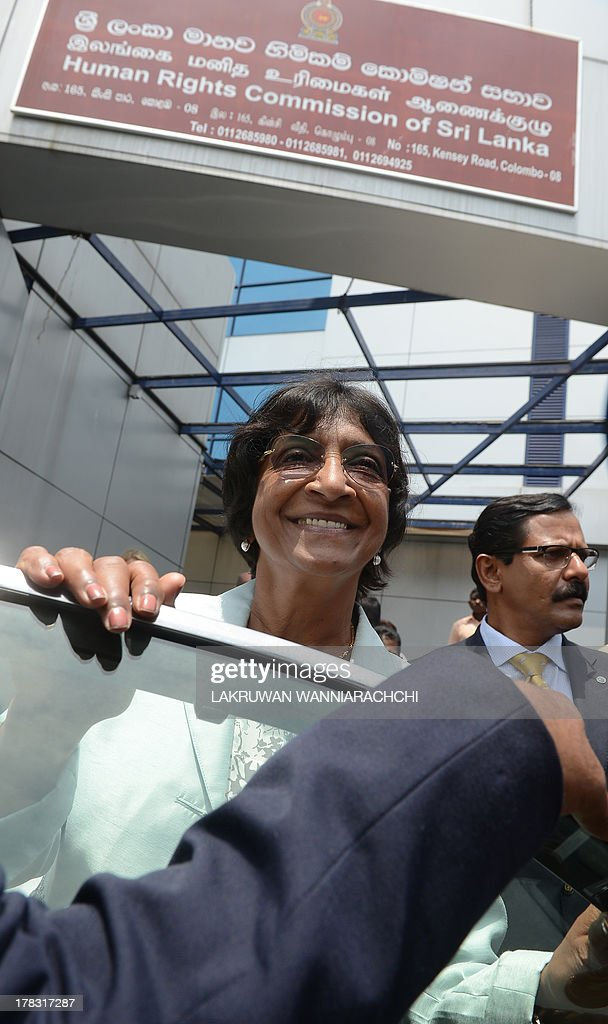 UN human rights chief Navi Pillay gets into a vehicle outside the Sri Lanka Human Rights Commission in Colombo on August 29, 2013. Pillay is on a week-long fact-finding mission to Sri Lanka after the government dropped public hostility towards her and promised access to former war zones. AFP PHOTO/ LAKRUWAN WANNIARACHCHI