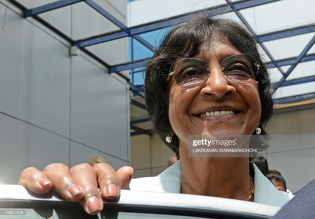 UN human rights chief Navi Pillay stands at a vehicle outside the Sri Lanka Human Rights Commission in Colombo on August 29, 2013. Pillay is on a week-long fact-finding mission to Sri Lanka after the government dropped public hostility towards her and promised access to former war zones.
