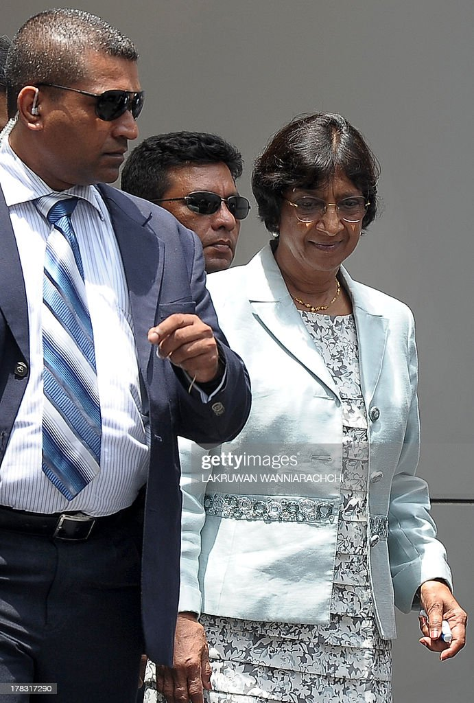 UN human rights chief Navi Pillay (R) walks with officials outside the Sri Lanka Human Rights Commission in Colombo on August 29, 2013. Pillay is on a week-long fact-finding mission to Sri Lanka after the government dropped public hostility towards her and promised access to former war zones.