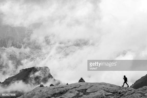Human silhouette standing out in a dramatic mountain landscape