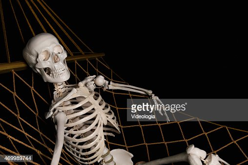 human skeleton swingig on hammock stock photo | thinkstock, Skeleton