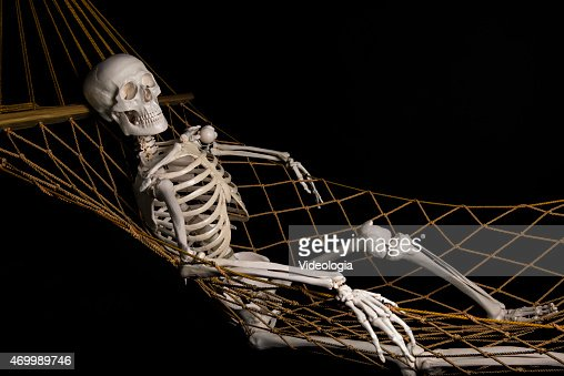 human skeleton swinging on hammock stock photo | thinkstock, Skeleton