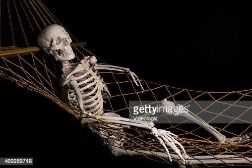 human skeleton swinging on hammock stock photo   thinkstock, Skeleton