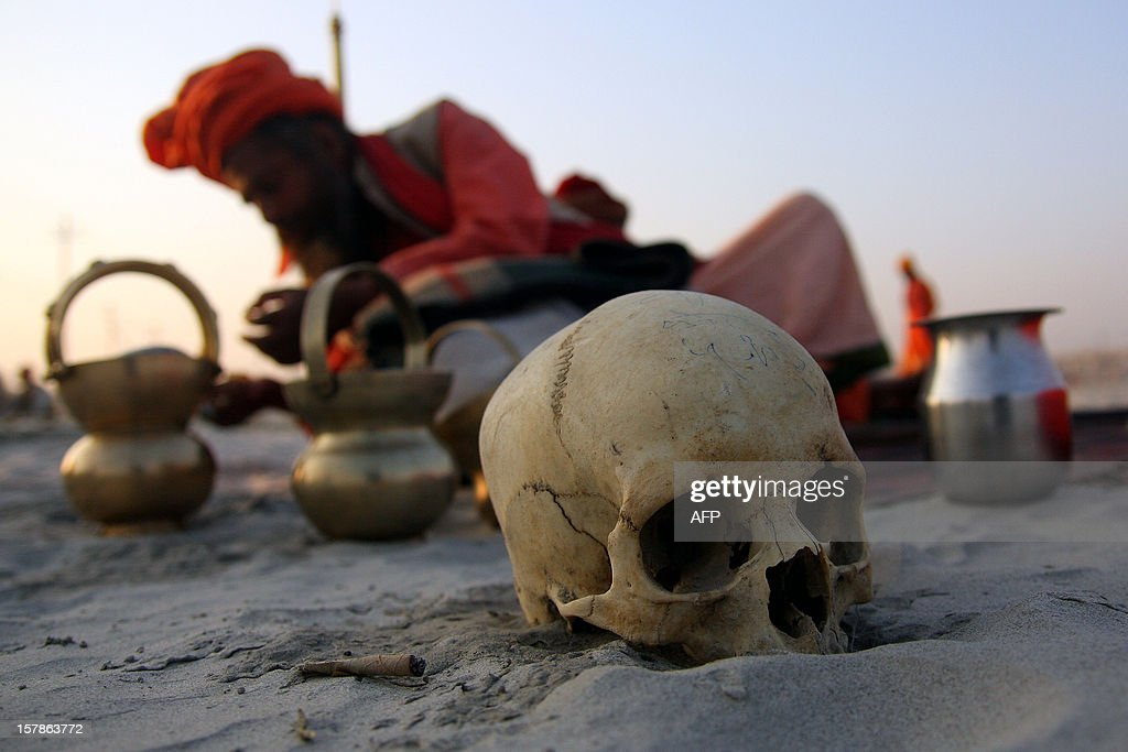 A human skull is pictured as a Hindu holy man prepares for a ritual after his arrival at Sangam to participate in the upcoming Maha Kumbh Festival, in Allahabad on December 7, 2012. The Kumbh Mela is the largest gathering of people for a religious purpose in the world and millions of people gather for this auspicious occasion.