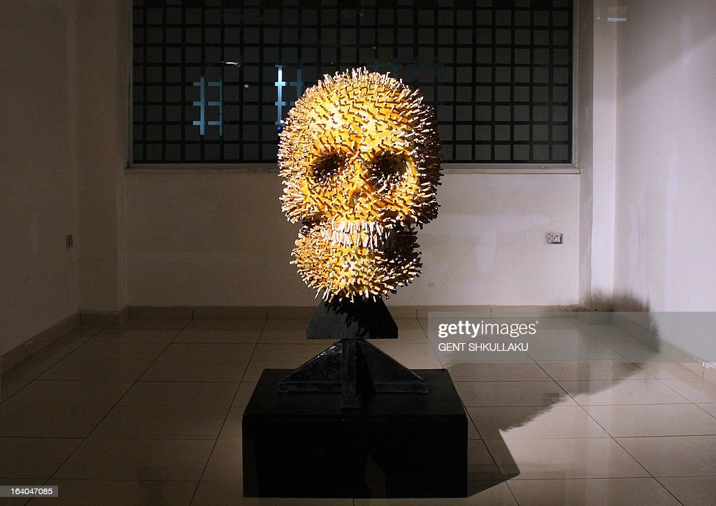 A human skull made of cigarette butts by Albanian artists Lumturi Blloshmi is displayed as a warning at the entrance of a health clinic in Tirana on March 19, 2013. Inspite of a smoking ban in public places voted in 2007 the law is widely ignored and cigarette butts are the most common litter in many Albanian streets.