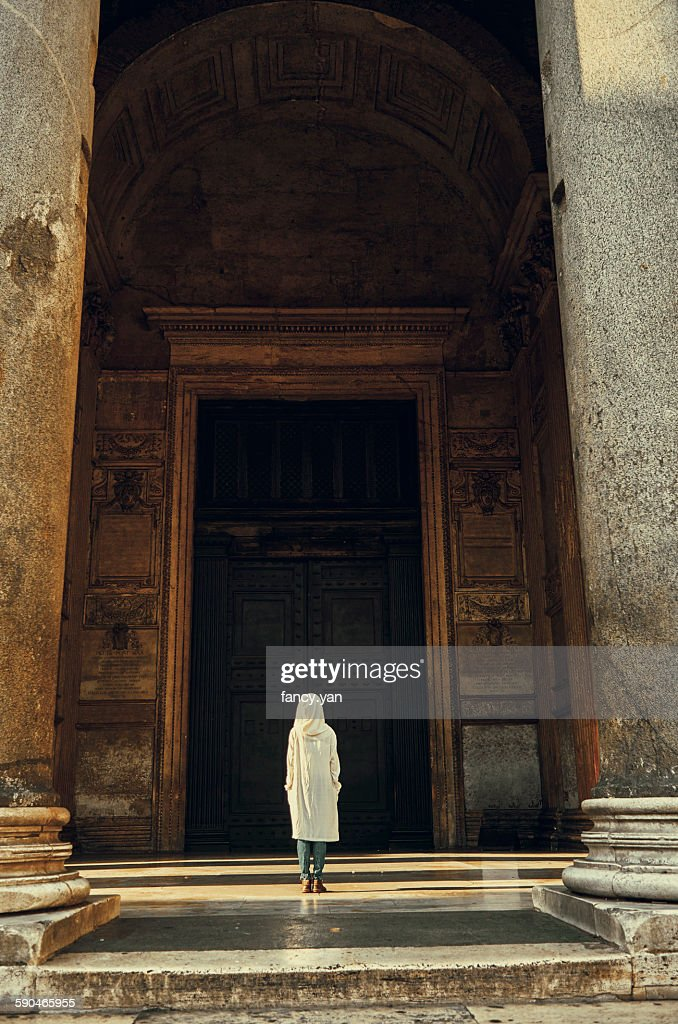Human standing in front of Pantheon in Rome