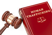 Human trafficking concept with gavel and book, 3D rendering