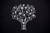 tree with human man and woman silhouettes instead of leaves. Concept of social network, teamwork and family tree.