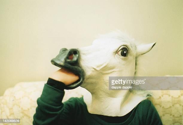 Human wearing horse mask