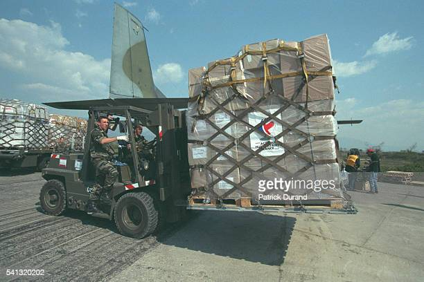 Humanitarian aid packages arrive at Tirana Palettes are unloaded from the miltary aircraft