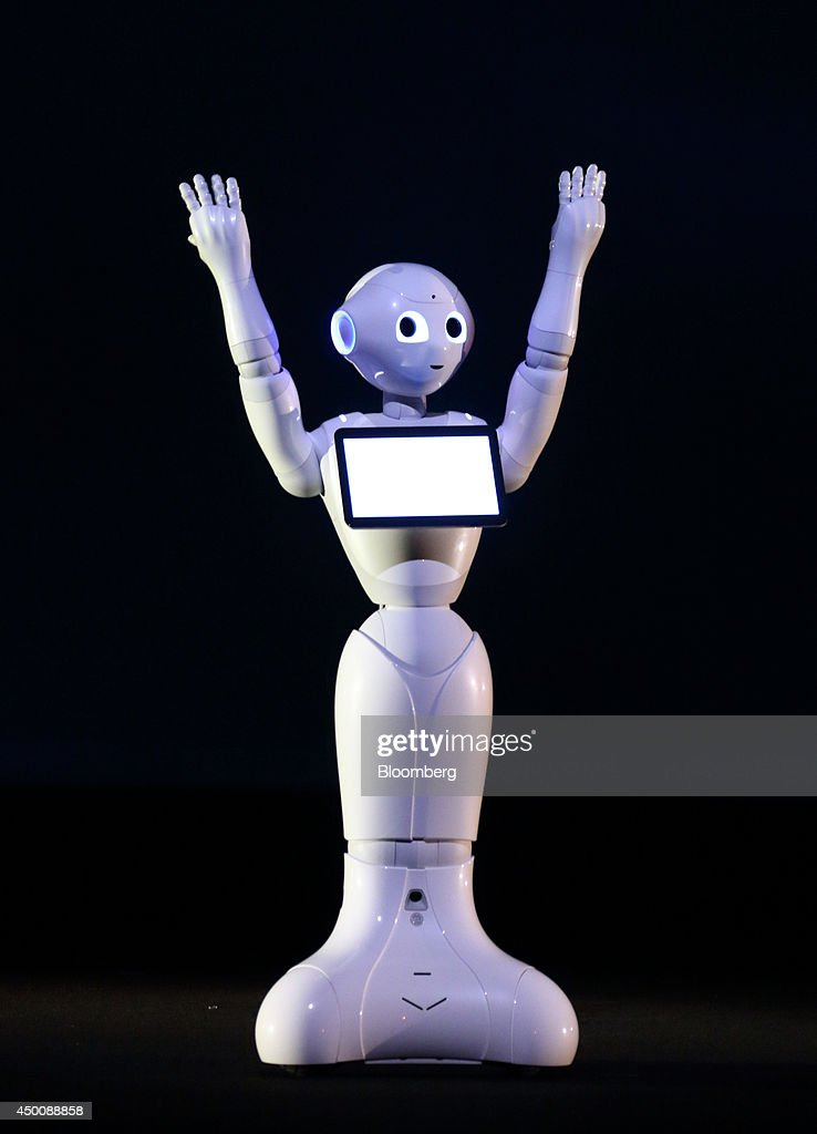 A human-like robot called Pepper, developed by SoftBank Corp.'s Aldebaran Robotics unit, raises it's arms during a news conference in Urayasu, Chiba Prefecture, Japan, on Thursday, June 5, 2014. SoftBank plans to sell interactive robots for households from February next year. Photographer: Tomohiro Ohsumi/Bloomberg via Getty Images