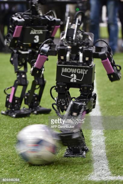 A humanoid from France's Bordeaux University kicks the ball during the kidsize android football tournament final against a Chinese team at the...