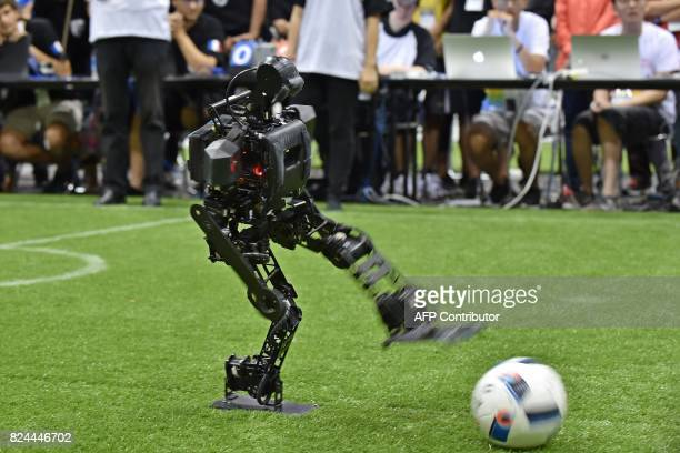 A humanoid from the Chinese team kicks the ball in the final of the kidsize android football tournament against France's Bordeaux University at the...