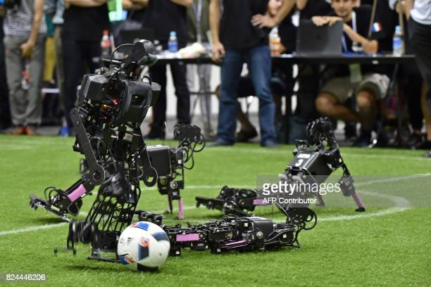 A humanoid from the Chinese team takes part in the final of the kidsize android football tournament against France's Bordeaux University at the...