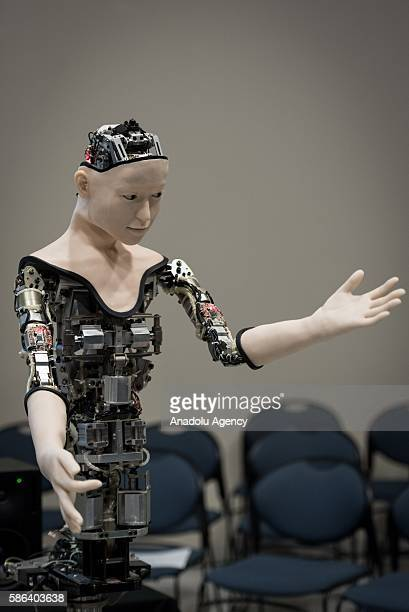 A humanoid robot called Alter designed by scientists in Japan is seen during the exhibition at the National Museum of Emerging Science and Innovation...