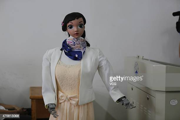 A humanoid robot called Xiao Mei speaks to students in a classroom at Jiujiang University on June 3 2015 in Jiujiang China The robot was created by...