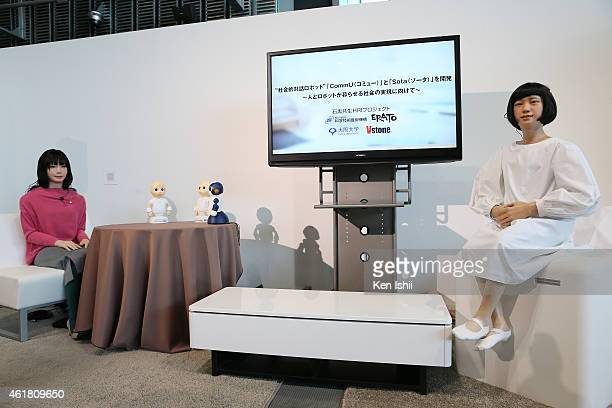Humanoid robot 'Otonaroid' and 'Kodomoroid' are seen during the press conference to introduce the sociable robots 'CommU' and 'Sota' hosted by only...