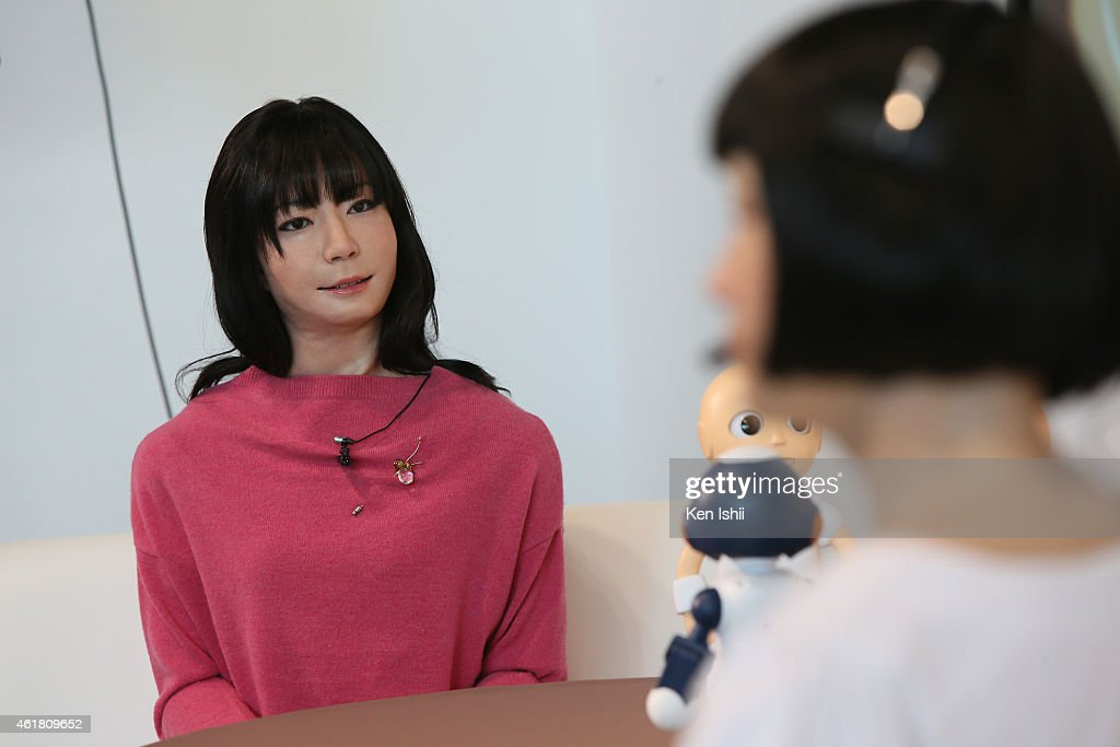 Humanoid robot 'Otonaroid' talks with 'Kodomoroid' during the press conference to introduce the sociable robots, 'CommU' and 'Sota' hosted by only the robot science communicator Otonaroid and the robot anchor Kodomoroid at the National Museum of Emerging Science and Technology (Miraikan) on January 20, 2015 in Tokyo, Japan. CommU and Sota, developed to improve humanoids' sense of interaction in dialogue, make people feel more engaged in conversation with them by featuring diverse eye movements and gaze directions.