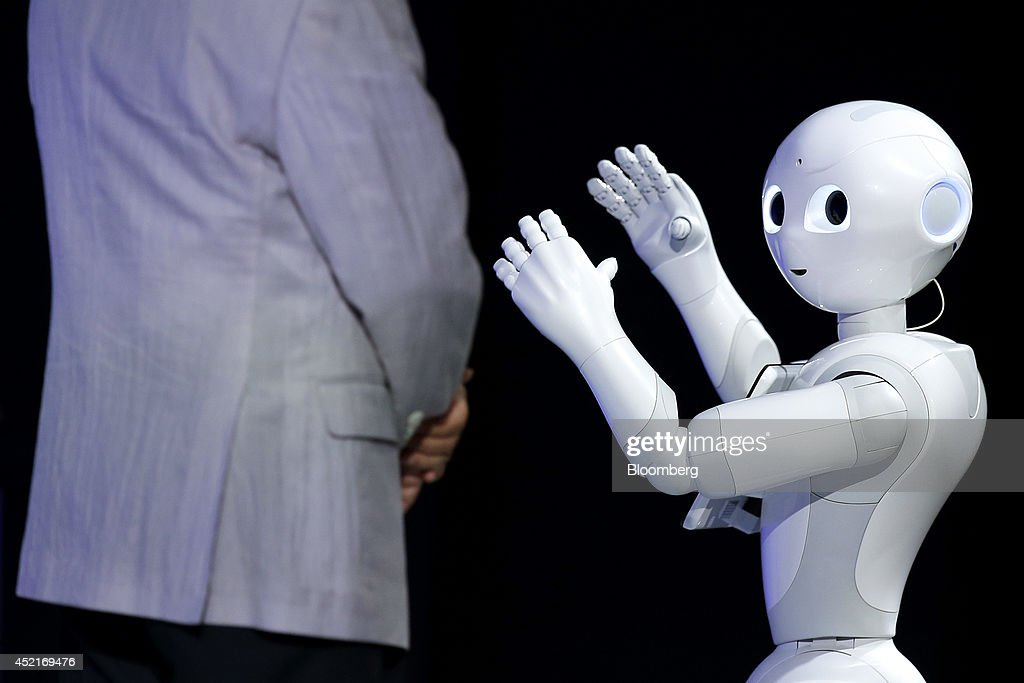 Humanoid robot Pepper, developed by SoftBank Corp.'s Aldebaran Robotics unit, performs next to <a gi-track='captionPersonalityLinkClicked' href=/galleries/search?phrase=Masayoshi+Son&family=editorial&specificpeople=632759 ng-click='$event.stopPropagation()'>Masayoshi Son</a>, chairman and chief executive officer of SoftBank Corp., at SoftBank World 2014 in Tokyo, Japan, on Tuesday, July 15, 2014. As Son pushes for a takeover of T-Mobile US Inc., the Japanese billionaire is asking banks to commit financing for a longer-than-usual amount of time, underscoring the intense regulatory review he faces. Photographer: Kiyoshi Ota/Bloomberg via Getty Images
