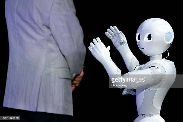Humanoid robot Pepper developed by SoftBank Corp's Aldebaran Robotics unit performs next to Masayoshi Son chairman and chief executive officer of...