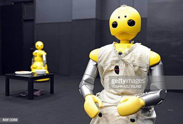 Humanoid robots Wakamaru produced by Japan's Mitsubishi Heavy Industry named Momoko and Takeo in the performace take part in a drama for the world's...