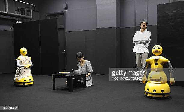 Humanoid robots Wakamaru produced by Japan's Mitsubishi Heavy Industry named Momoko with Takeo take part with actress Minako Inoue with actor Hiroshi...