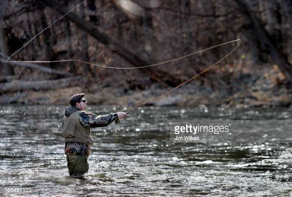 WEATHER 1 / 03/27/06 Humber College student John Innes spends the last day of the college teachers strike by flyfishing for Steelhead on the Credit...