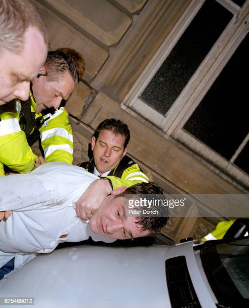 Humberside Police officers restrain a man suspected of causing a public order offence while under the influence of alcohol April 2004