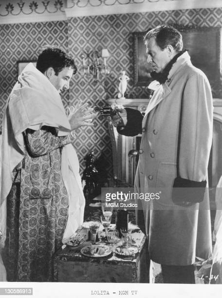 Humbert Humbert played by James Mason holds Clare Quilty played by Peter Sellers at gunpoint in a scene from 'Lolita' directed by Stanley Kubrick 1962