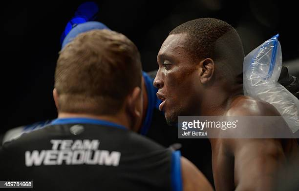 Humberto Brown rests in his corner between rounds against Gabriel Benitez in their featherweight bout during the UFC 180 event at Arena Ciudad de...
