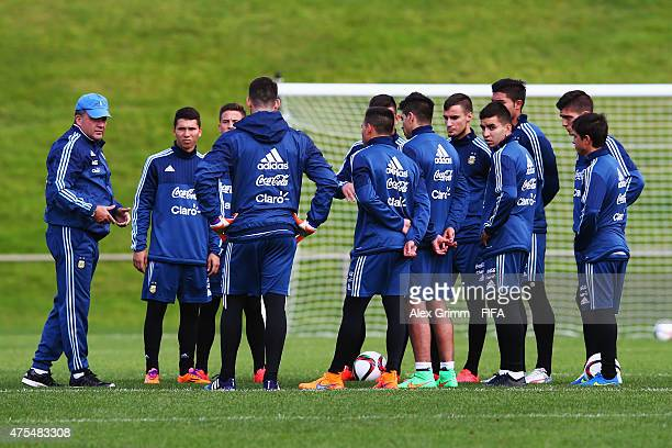 Humberto Grondona talks to the players during an Argentina U20s training session at Porirua Park on June 1 2015 in Wellington New Zealand