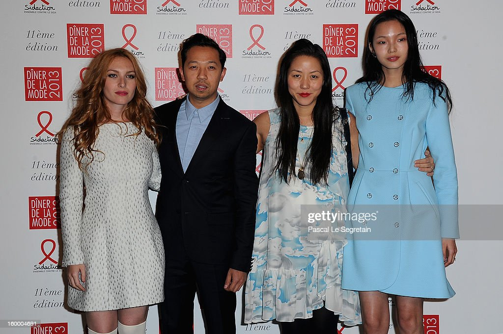 Humberto Leon (2nd), Carol Lim and guests pose as they arrive to attend the Sidaction Gala Dinner 2013 at Pavillon d'Armenonville on January 24, 2013 in Paris, France.