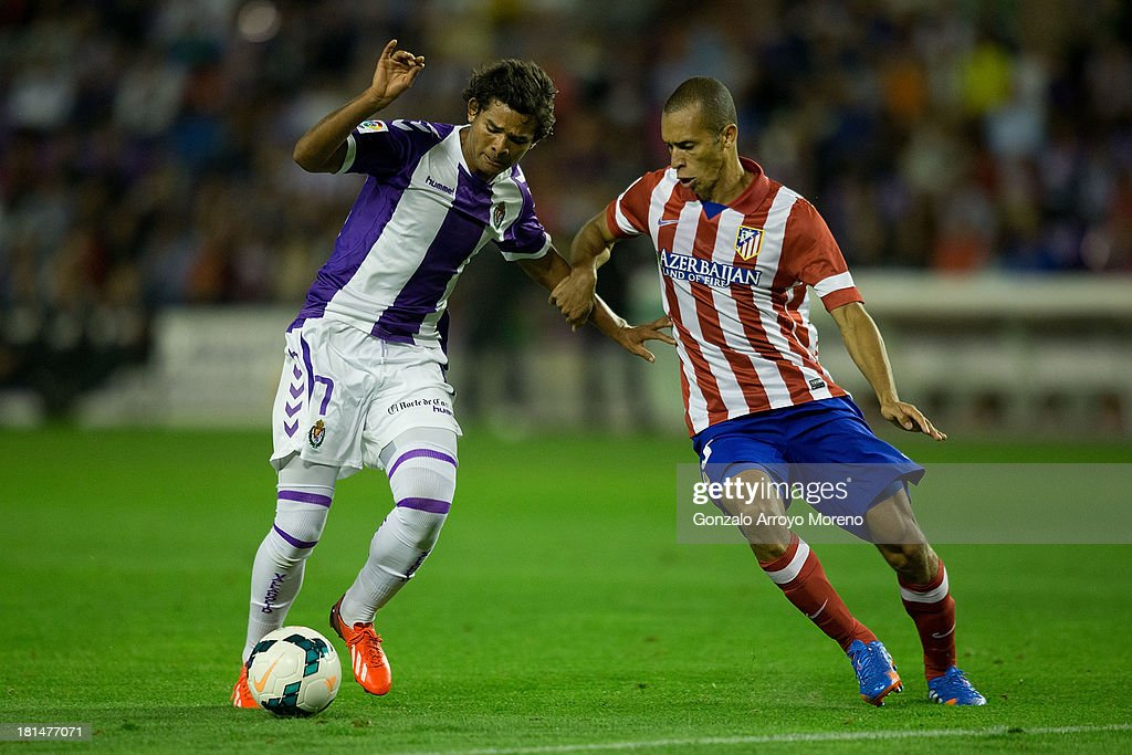 Humberto Osorio (L) of Real Valladolid CF competes for the ball with Joao Miranda of Atletico de Madrid during the La Liga match between Real Valladolid CF and Club Atletico de Madrid at Estadio Jose Zorilla on September 21, 2013 in Valladolid, Spain.