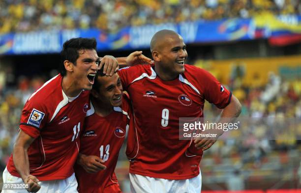 Humberto Suazo Fabian Orellana and Mark Gonzalez of Chile celebrate second scored goal against Colombia during their FIFA World Cup South Africa2010...