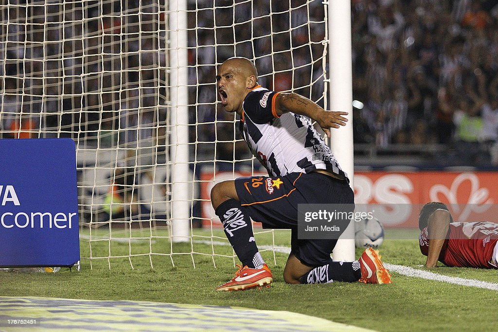 <a gi-track='captionPersonalityLinkClicked' href=/galleries/search?phrase=Humberto+Suazo&family=editorial&specificpeople=6592326 ng-click='$event.stopPropagation()'>Humberto Suazo</a> of Monterrey celebrates a goal against Tijuana during a match between Monterrey and Tijuana as part of the Apertura 2013 Liga Bancomer MX at Tecnologico Stadium on August 17, 2013 in Monterrey, Mexico.