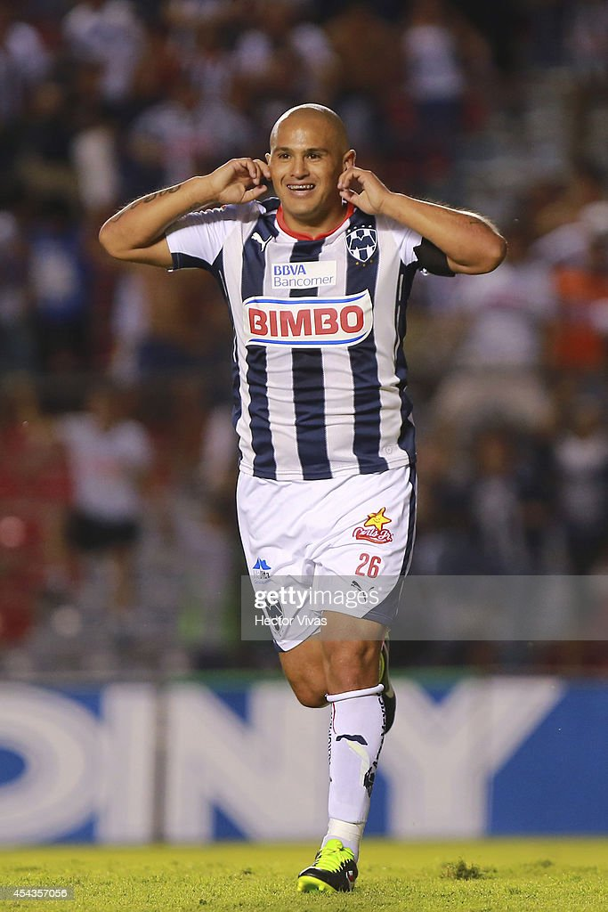 <a gi-track='captionPersonalityLinkClicked' href=/galleries/search?phrase=Humberto+Suazo&family=editorial&specificpeople=6592326 ng-click='$event.stopPropagation()'>Humberto Suazo</a> of Monterrey celebrates after scoring the only goal of a match between Queretaro and Monterrey as part of 7th round Apertura 2014 Liga MX at Corregidora Stadium on August 29, 2014 in Queretaro, Mexico.