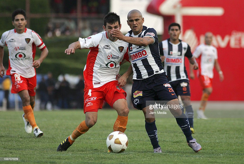 Humberto Suazo (R) of Monterrey struggles for the ball with Ismael Fuentes (L) of Jaguares during a match as part of the Apertura 2010 at Tecnologico Stadium on August 28, 2010 in Monterrey, Mexico.