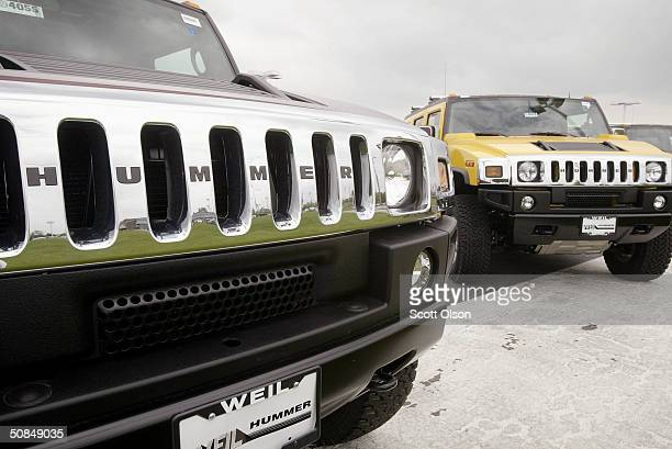 Hummer H2s sit on the lot of Weil Hummer May 17 2004 in Libertyville Illinois Faced with slumping sales GM has started offering rebates on the...