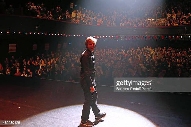 Humorist Alex Lutz acknowledges the applause of the audience at the end of his One man Show at L'Olympia on January 24 2015 in Paris France