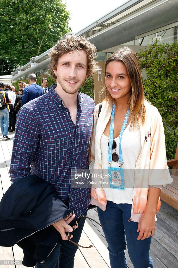Humorist Baptiste Lecaplain and Funboard Champion Alice Arutkin attend the 2016 French Tennis Open - Day Four at Roland Garros on May 25, 2016 in Paris, France.