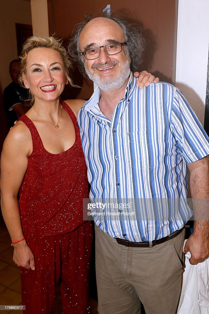 Humorist Christelle Chollet with stage director Alain Sachs after her one woman show 'The New Show', written and set stage by Remy Caccia at 29th Ramatuelle Festival day 10 on August 9, 2013 in Ramatuelle, France.