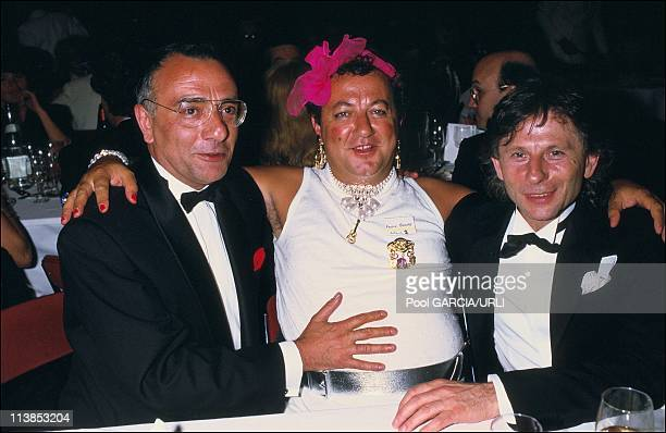 Humorist Coluche journalist Yves Mourousi and film director Roman Polanski at Cannes Film Festival in May 1986