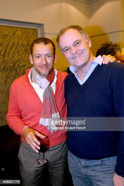 Humorist Dany Boon and Director Christian Carion pose backstage following the show of impersonator Laurent Gerra 'Un spectacle Normal' at L'Olympia...