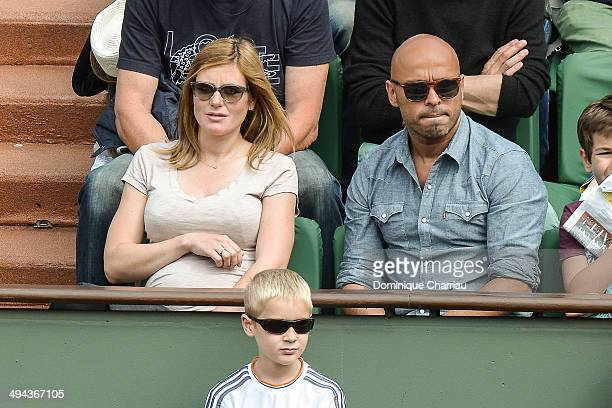 Humorist Eric Judor and his companion attend the Roland Garros French Tennis Open 2014 Day 5 on May 29 2014 in Paris France