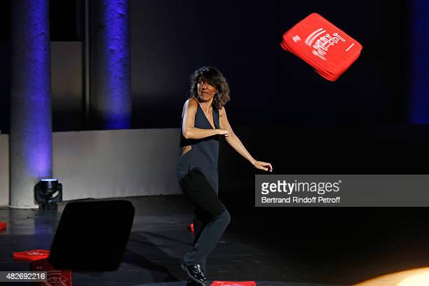 Humorist Florence Foresti acknowledges the applause of the audience during the traditional throw of cushions at the final of the 'Madame Foresti'...