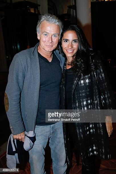 Humorist Franck Dubosc and his wife Daniele Dubosc attend JeanDaniel Lorieux signs his Book 'Sunstroke' at the Art Bookshop of the 'Royal Monceau...