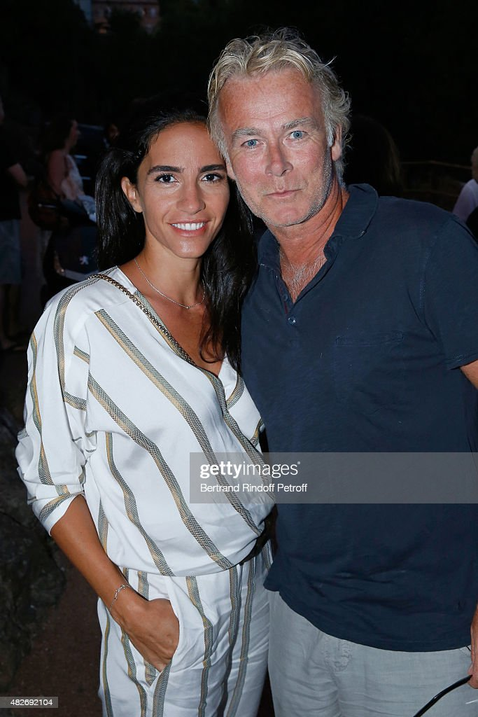 Humorist Franck Dubosc and his wife Daniele Dubosc attend the 'Madame Foresti' show of Humorist Florence Foresti during the 31th Ramatuelle Festival : Day 1 on August 1, 2015 in Ramatuelle, France.