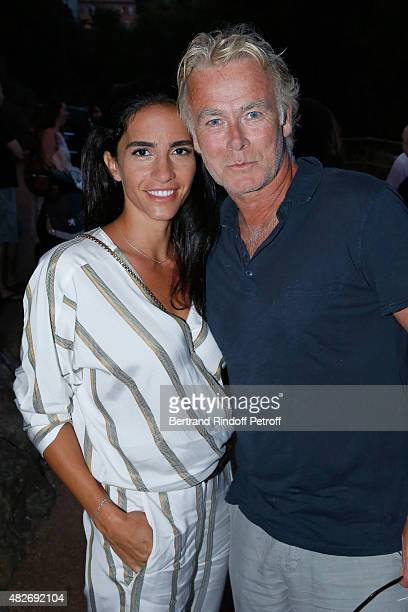Humorist Franck Dubosc and his wife Daniele Dubosc attend the 'Madame Foresti' show of Humorist Florence Foresti during the 31th Ramatuelle Festival...