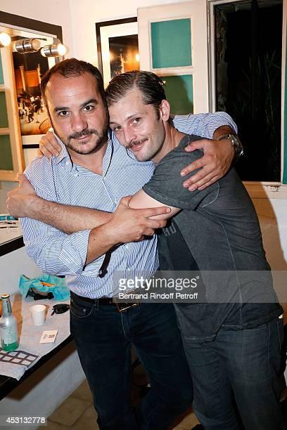 Humorist Francois Xavier Demaison and actor Nicolas Duvauchelle pose after 'Des journees entieres dans les arbres' play at the 30th Ramatuelle...