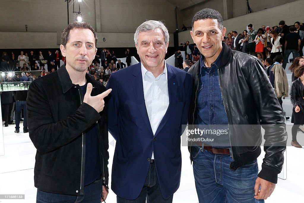 Humorist <a gi-track='captionPersonalityLinkClicked' href=/galleries/search?phrase=Gad+Elmaleh&family=editorial&specificpeople=586672 ng-click='$event.stopPropagation()'>Gad Elmaleh</a>, CEO Dior <a gi-track='captionPersonalityLinkClicked' href=/galleries/search?phrase=Sidney+Toledano&family=editorial&specificpeople=758670 ng-click='$event.stopPropagation()'>Sidney Toledano</a> and actor <a gi-track='captionPersonalityLinkClicked' href=/galleries/search?phrase=Roschdy+Zem&family=editorial&specificpeople=606839 ng-click='$event.stopPropagation()'>Roschdy Zem</a> attend Dior Homme Menswear Spring/Summer 2014 Show as part of the Paris Fashion Week on June 29, 2013 in Paris, France.